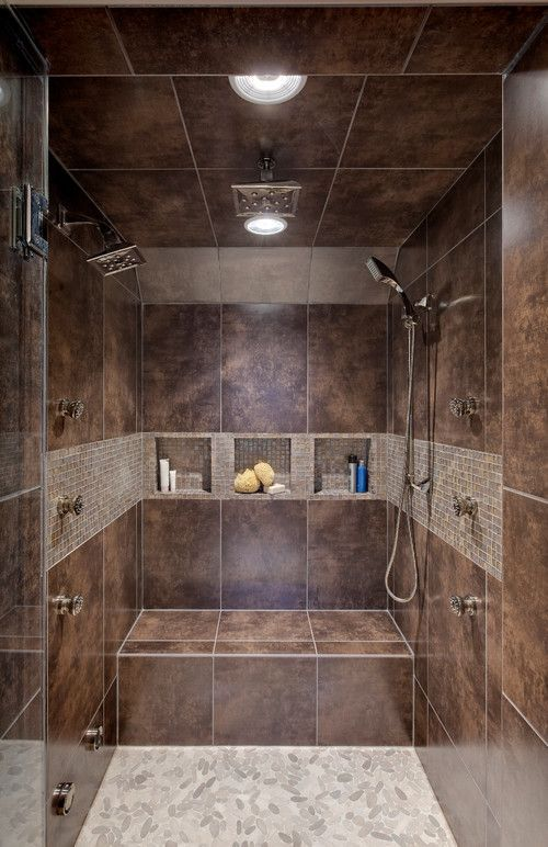 I love the color of this tile, and the large square shower heads.