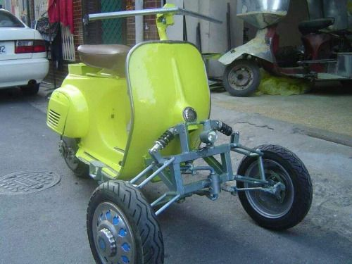 Reverse trike Vespa and goodness knows what that is in the background?