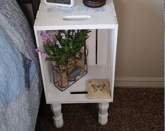 This Cute Dark Gray Painted Crate Nightstand Is a perfect addition to your home. With Cute little legs this nightstand is unique. These nightstands are very sturdy even though they are somewhat tall. Legs are glued in using premium wood glue and we sand the bottom of the legs to minimize teetering. Crate Nightstand measures; 12.5 wide 9.5 deep 27 tall which allows it to fit in almost any home. Order yours today.  It looks fantastic with our Toy Chest as well…