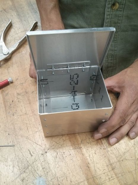 A riveted metal box with lid                                                                                                                                                      More