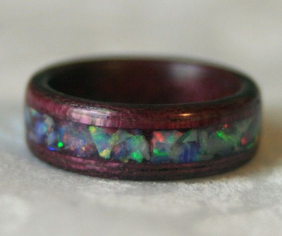 possibly the most beautiful ring I've seen in ages... bent purplewood ring with a crushed opal inlay = <3 <3 <3   $115  Soo if I have a opal wedding ring maybe my husband will want this to match ;)
