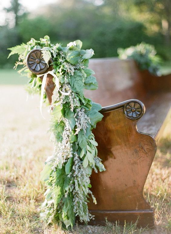 Vintage Church Pew Draped in a Greenery Garland for a Rustic Ceremony | KT Merry Photography | Earthy and Elegant Rustic Wedding in Dusty Blue and Taupe - http://heyweddinglady.com/earthy-elegant-rustic-wedding-dusty-blue-taupe