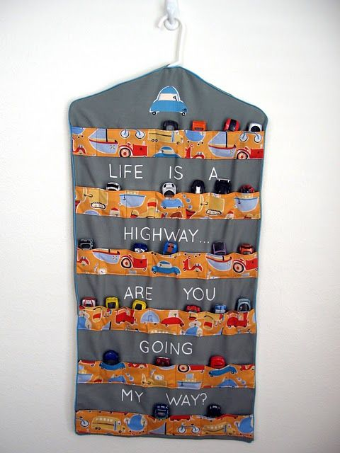 Matchbox Car Hanging organizer Altanta loves cars BUT PLEASE IN HER ROOM COLORS AND FABRICS thinks cute shabby whimsy girl not primary and or boy at all she is girly girl that is for sure...but loves her cars too and has prob 50 of them so this would be great