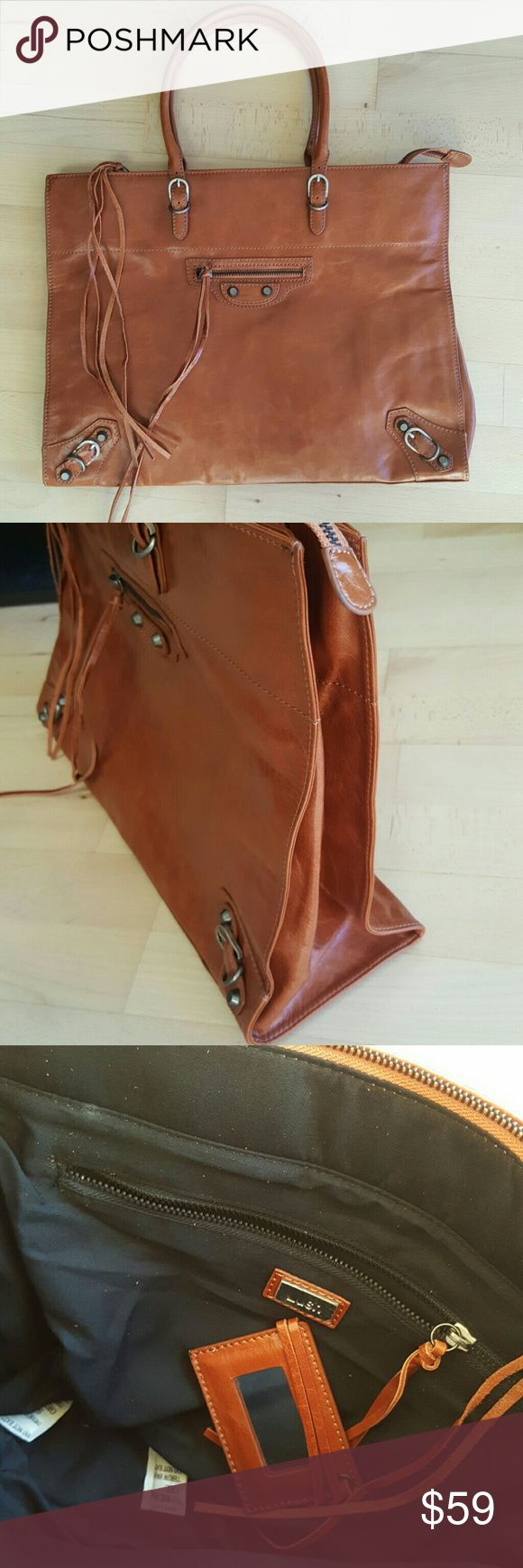New cognac Brown leather motorcycle biker tote bag Brand new Lush brand cognac brown leather bag. Inspired by the Balenciaga motorcycle bag this bag is perfect as a laptop bag or an office bag. Comes with detachable mirror this classic style is even better in person Lush Bags Totes