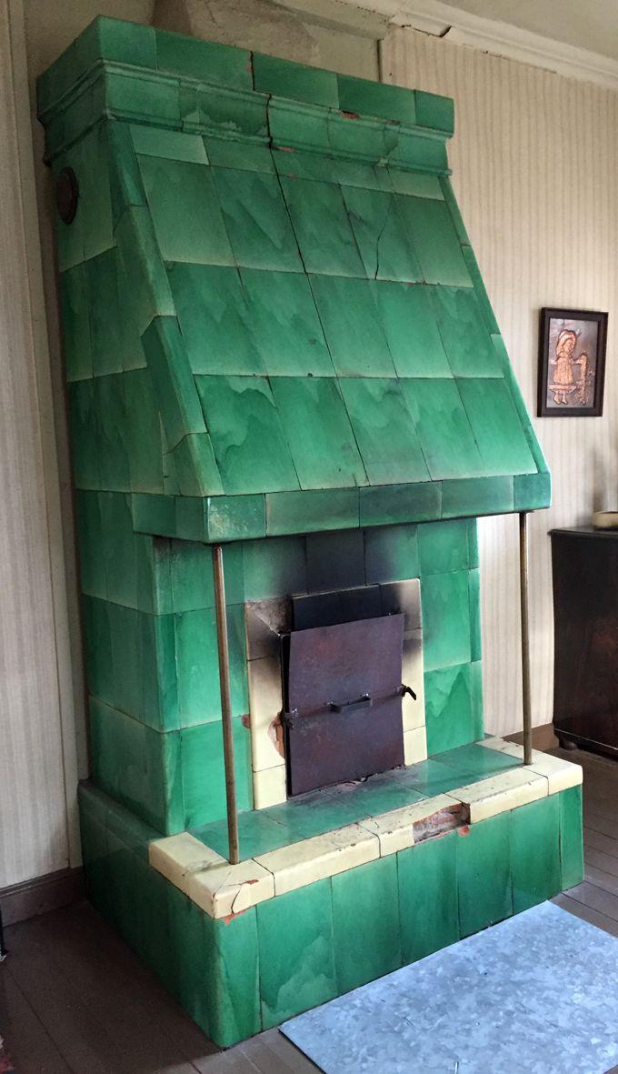 Antique tiled stove waiting for restoration.