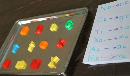preparing hte letter matching game with magnet letters