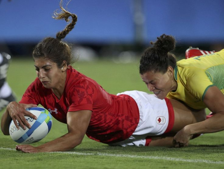 Canada's Bianca Farella scores a try as she is tackled by Mariana Ramalho of Brazil. Women's rugby sevens made its Olympic debut Saturday.