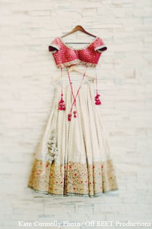 Lovely dress shot of this cream, red and gold lehenga.
