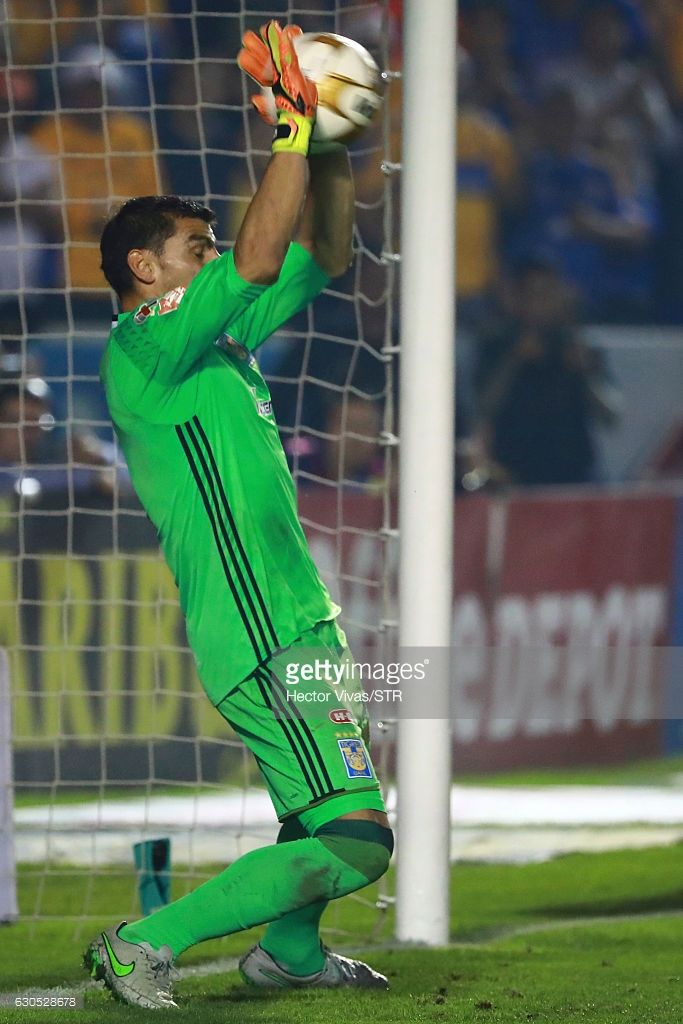Nahuel Guzman of Tigres stops a penalty shot by Silvio Romero (not in frame)during the Final second leg match between Tigres UANL and America as part of the Torneo Apertura 2016 Liga MX at Universitario Stadium on December 25, 2016 in Monterrey, Mexico.