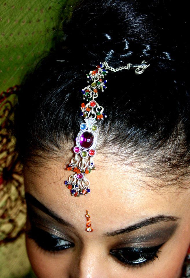 The multicultural headpiece used in Asia to enable a colourful side of Asian Fashion shown within this image.