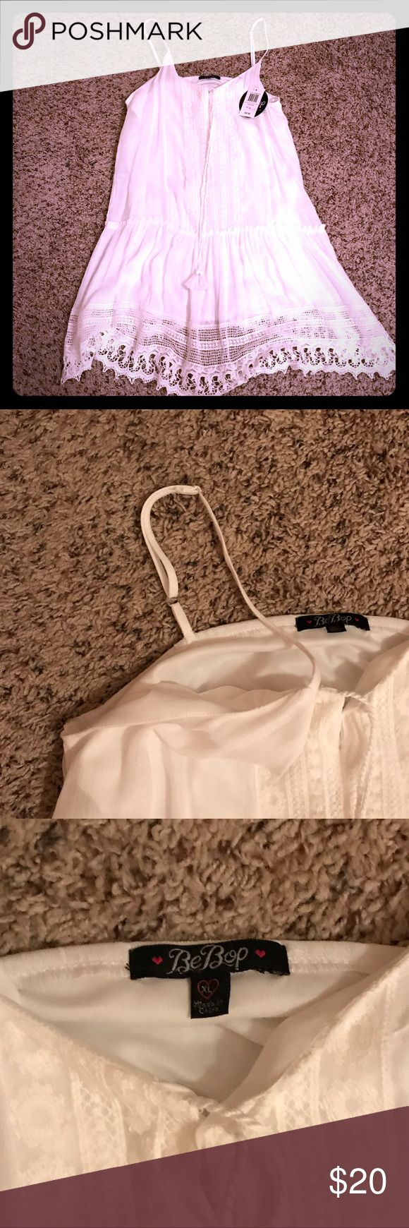 Junior white dress, fully lined BeBop size XL NWT White fully lined detailed dress, size XL NWT. Adjustable straps. 28 inches long from bottom of arm pit measurement. Cotton - polyester blend. So cute for summer 💕💕 BeBop Dresses