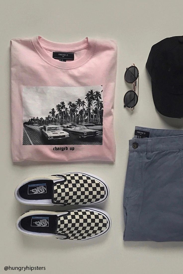 "A cotton knit tee featuring a crew neckline, short sleeves, and a graphic with a palm tree landscape, vintage cars and ""Charged Up"" in raised velvet lettering."