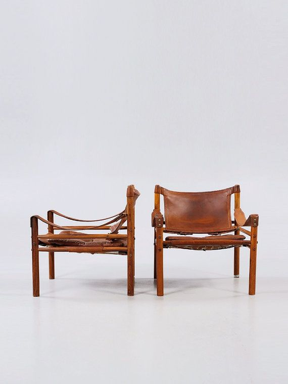 Rare authentic vintage pair of Arne Norell safari sirocco chair in rosewood and brown leather, 1960s. Sweden. Authentic pair of chairs from the 60s in
