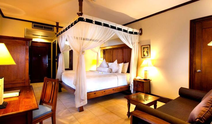 Executive Deluxe Ramayana Resort and Spa is a beautiful and comfortable guest room with Balinese decor and mosquito's net cover the bed offers best rates