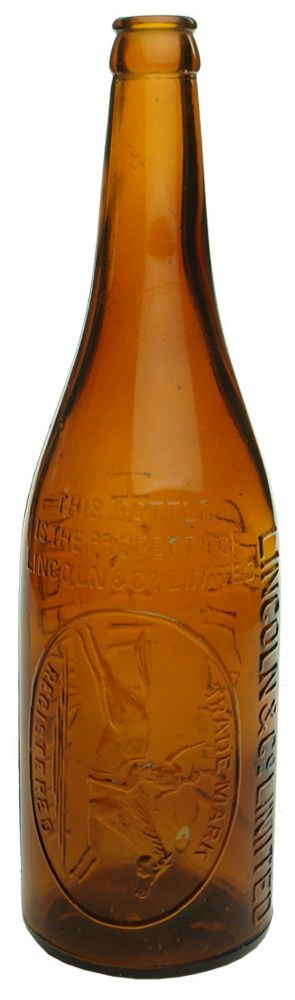 Embossing: Lincoln & Co Limited / This bottle / is the property of / Lincoln & Co Limited / Trade Mark / (Stockman on Horseback) / Registered // Narrandera / Hay, Hillston / Jerilderie. Smooth base. (New South Wales) Type: Beer Crown Seal /  Era: 1920s /  Variety: Champagne. Seam through lip. Amber. 26 oz. /  Height: 300 mm /  Condition: Excellent. Some scuffs and scratches and usual light wear. A very shallow burst bubble amongst the trade mark and a similar burst bubble at the lower back…