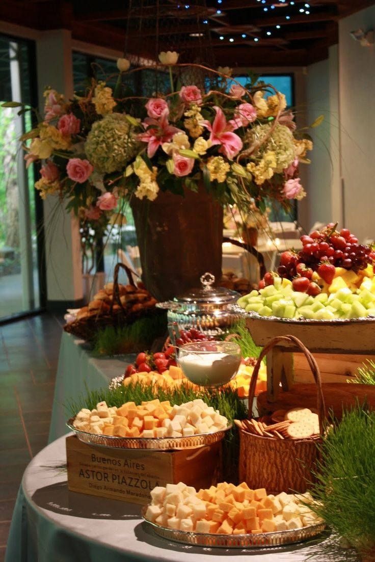 Cheese and fruit display with a beautiful arrangement