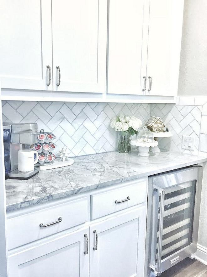 the backsplash is daltile m313 contempo white marble 36 tile laid on herringbone - White Kitchen