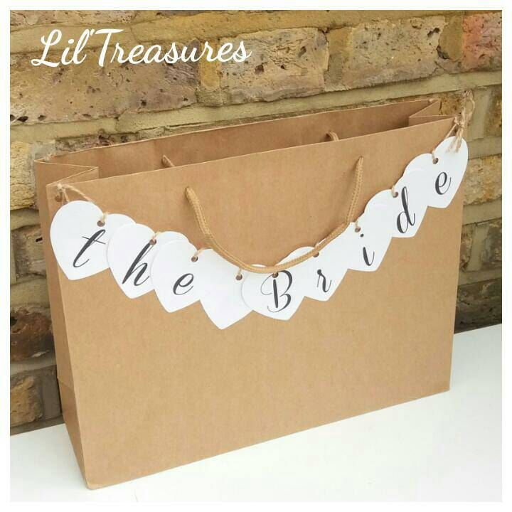 Large rustic brown gift bag with heart name bunting. Personalised party bags. Favors, Wedding, Hen Do, Birthday, bunting in any colour by LiltreasuresPrints on Etsy https://www.etsy.com/uk/listing/228189914/large-rustic-brown-gift-bag-with-heart