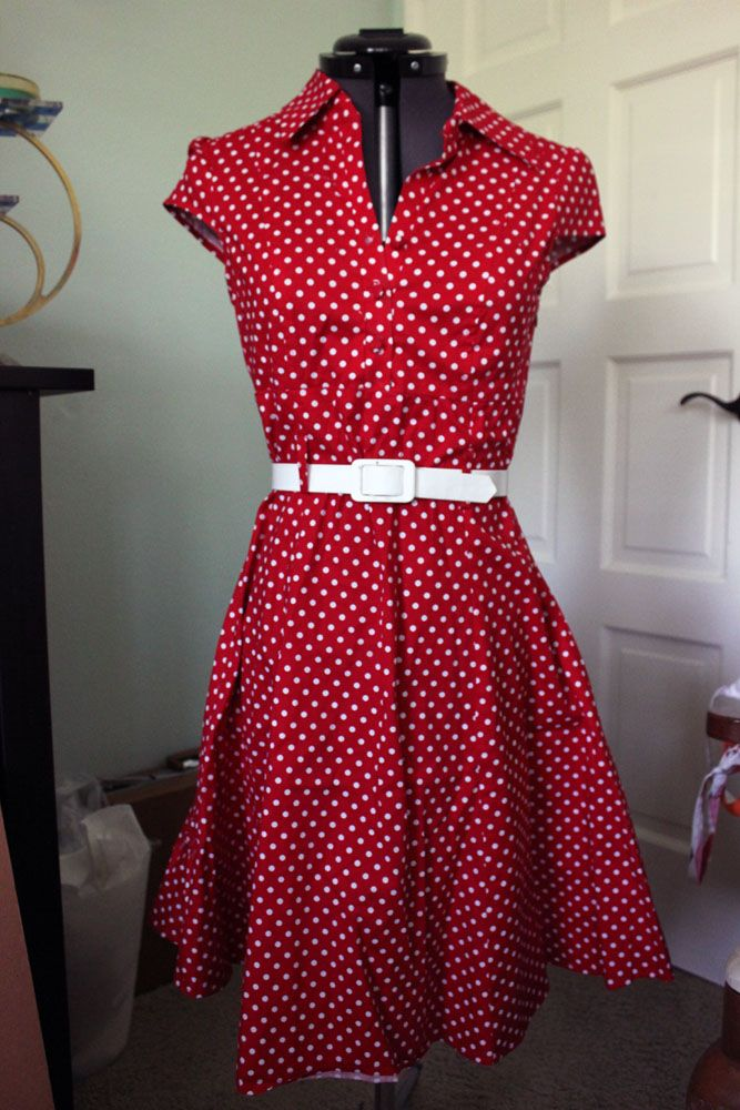 Red and white polka dot shirtwaist style dress from Modcloth. I forgot what the name of this dress was (soda shop or something like that?). I got this dress from a swap and love it but I don't wear it enough </3 One of the belt loops is detached on the back (white belt not included, just to show styling). Sell for $15 shipped