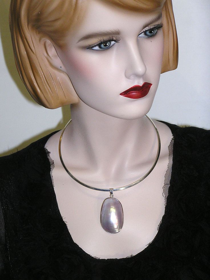 A personal favorite from my Etsy shop https://www.etsy.com/ca/listing/242058677/mother-of-pearl-silver-pendant-choker