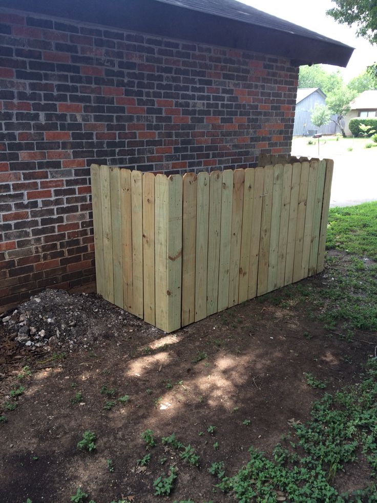 Completed fenced in trash/recycle area