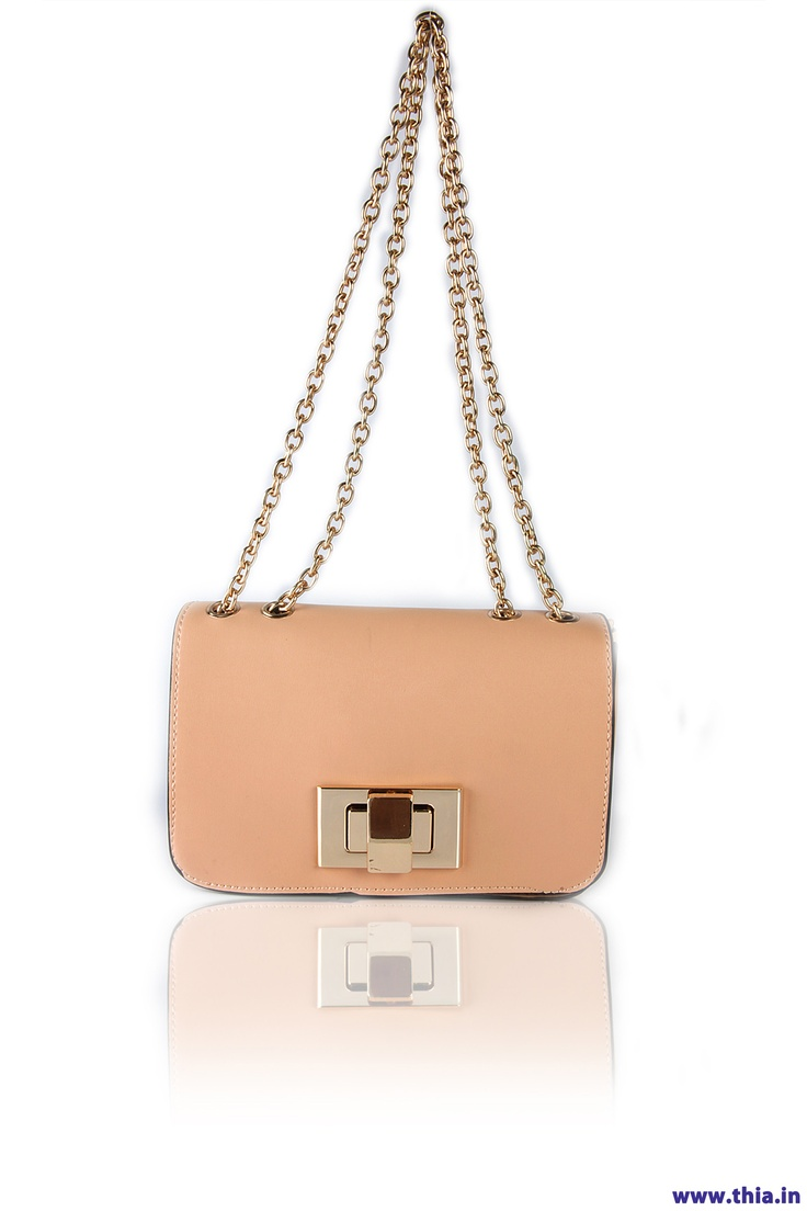 Sleek Creme Cross Body -  Body Crafted In Leather Look Fabric, Long Line Chain Shoulder Strap, Fold Over Flap With A Gold-Tone Twist Lock Fastening, Zipped Compartments In The Lining, Secured Body Through Zip Mouth Opening, Hardware In Gold......... - Rs. 1,250.00