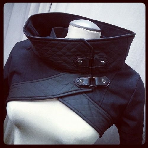 Plutonium, avant garde military cropped top/jacket with cowl neckline by Plastik Wrap.