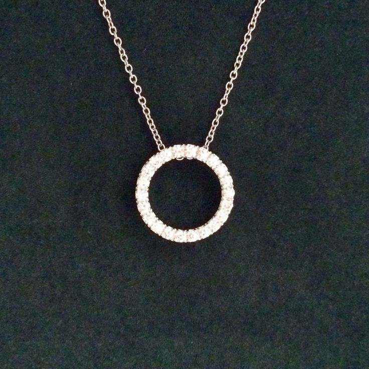 Stunning 18ct. diamond  eternal circle pendant 0.66crt.    #Est.1973
