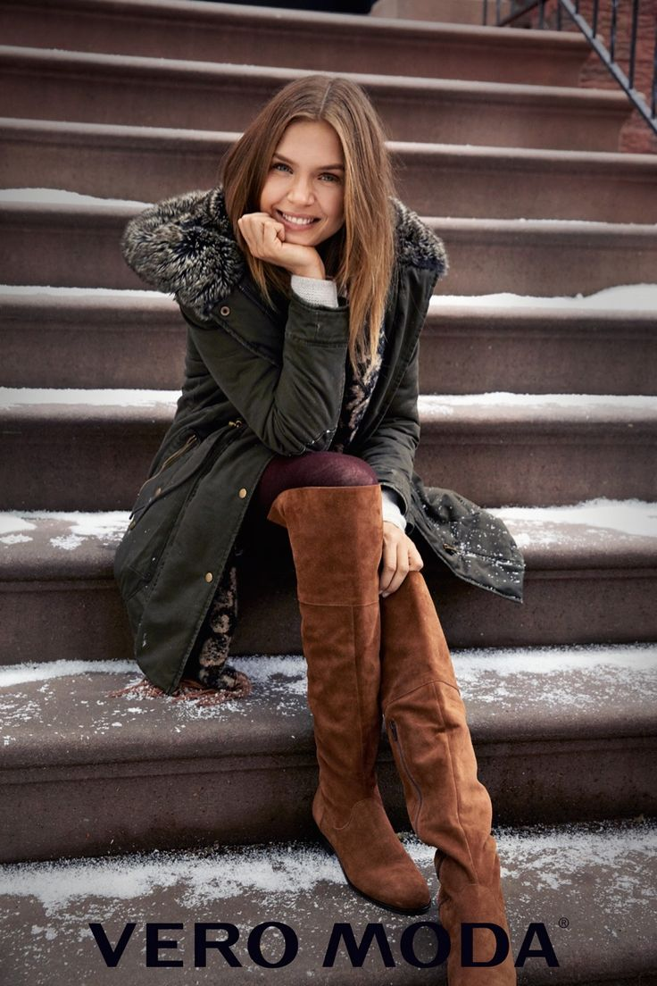 Posing on steps, Josephine Skriver covers up in a fur trimmed parka from Vero Moda 2016 campaign