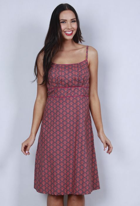 Cotton empire-line dress with adjustable straps, feature pleats at bust, and contrast binding.WAS $89  SALE PRICE $66