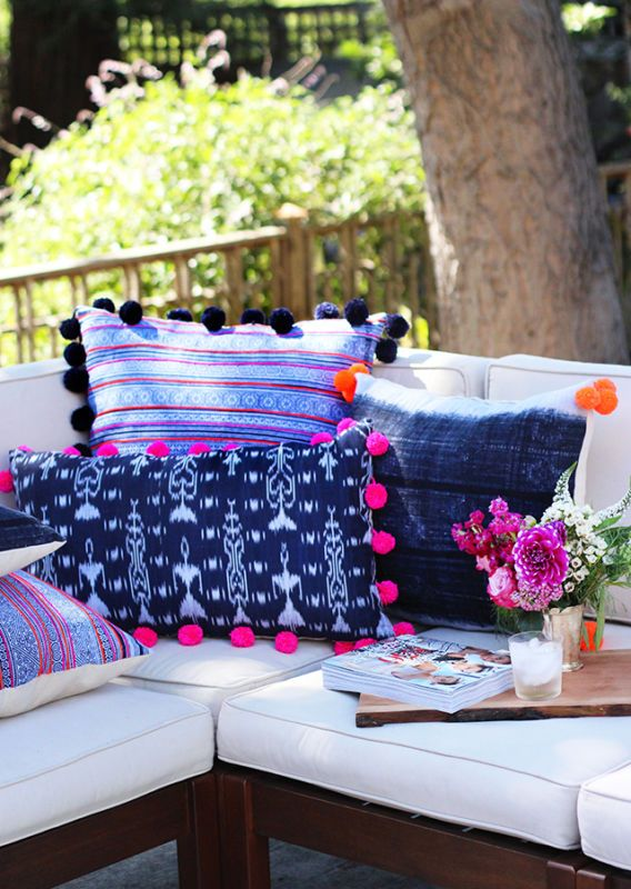 DIY Pom Pom Pillows - Love the ethnic-inspired prints and homemade pom pom combo!
