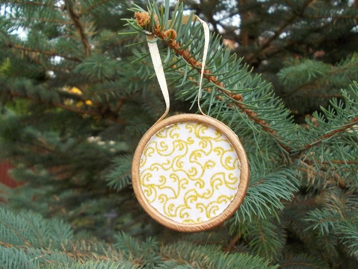 Antiqued wooden and textile decoration with tree xmas gold pattern
