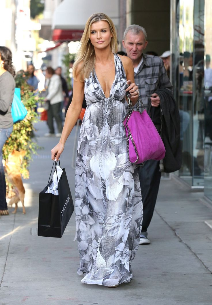 Joanna Krupa.. plunging halter dress, with purple Stella McCartney Python Print Falabella Bag..