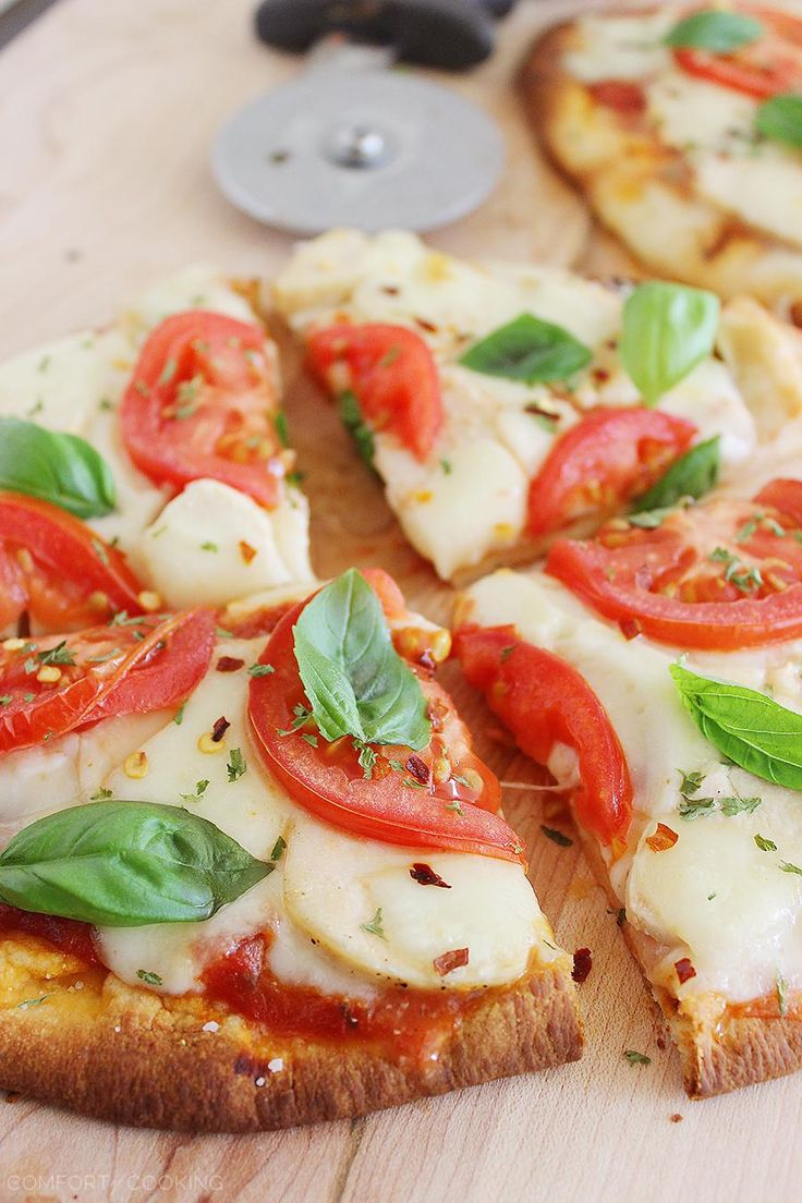 Cheesy Chicken Parmesan Flatbread Pizza – These cheesy, crisp chicken, mozzarella and tomato pizzas are so easy! Serve with a green salad for a healthy dinner. | thecomfortofcooking.com