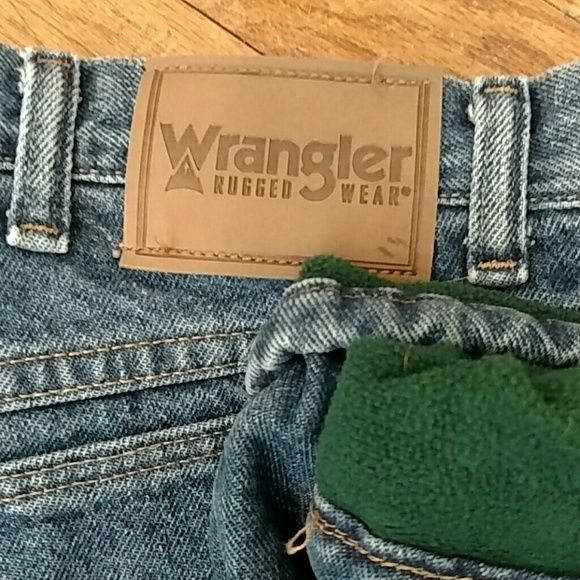 2 Pair!! Wrangler flannel lined jeans Men's Wrangler thinsulate lined jeans.  These jeans are nearly new no stains,frays,rips.  Super warm and thick.  Made with thinsulate lining one red pair and one green.  Anyone who has ever had to work outside in the cold can testify how wonderful these jeans are!! Wrangler Jeans Straight Leg