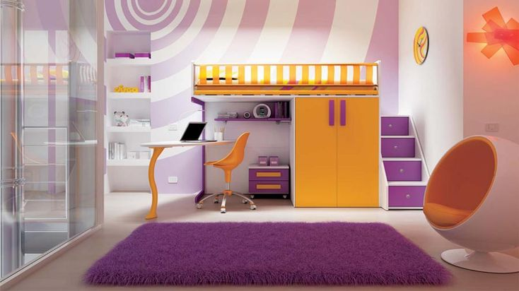 """Inspirations: In the kids's room, orange and purple strokes provide a vivid atmosphere with a Pop flair for instant happiness.  Here the furnishings set the tone: the bunk-bed bridges the wardrobe and the desk; the stairway has extra storage under each step for keeping """"secrets""""; the cozy pod-like armchair is perfect to enjoy some dreaming solitude. No doubts: from the splash of colours of the walls to the super soft rug, the space is playful and fun. #designbest @moretticompact 