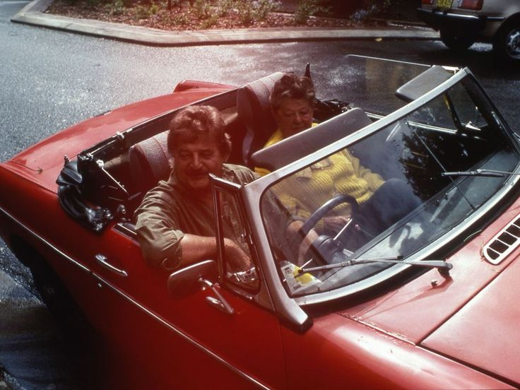 Peter Sculthorpe always seemed to have a red sports car… (Photographed here with composer Peggy Glanville-Hicks in the late 1980s)