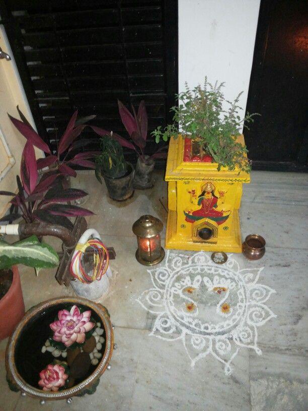 Traditional nook... tulasi kota. .. rangoli....loved it ...