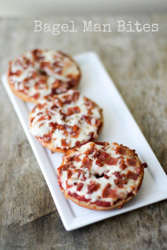 "Bagel Man Bites or ""Bagel Pizza"" - Made these last night as a Midnight snack. I used a regular sized bagel, so I had two pieces.  On the first I used Pizza Sauce, Reduced Fat Mozzarella Cheese, and Mini Spicy Pepperoni.  On the Second, I used a little bit of Butter; Sprinkled with Garlic Powder and Oregano, then topped that with Mozzarella Cheese.  I had a piece of Pepperoni Pizza and a piece of Cheesy Garlic Bread for the calories in a normal piece of pizza.  It was SO GOOD!"