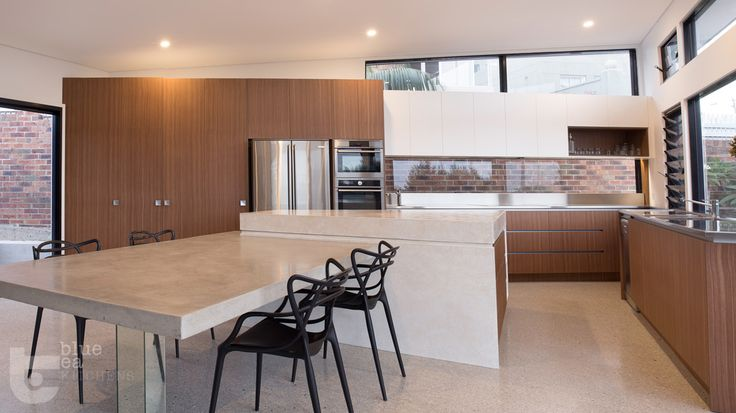 Kitchen island/ dining area. The support is in mirror so it looks transparent   Blue Tea Kitchens
