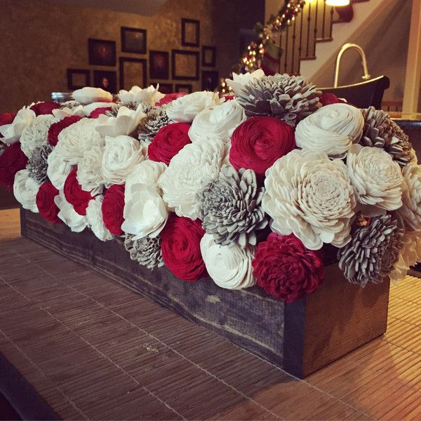 This flower bed centerpiece comes assembled with three colors.White and brown are included with a third color of your choice. In this photo, red represents the third color. This makes a great holiday centerpiece but can be a staple in your home all year round!