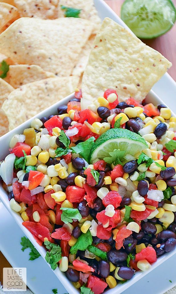 Corn and Black Bean Salsa | by Life Tastes Good is a sweet and spicy combination of corn, black beans, spicy tomatoes, onions, cilantro and lime to create an addictive salsa recipe perfect for any occasion. Appetizer, Salad, Mexican, Party