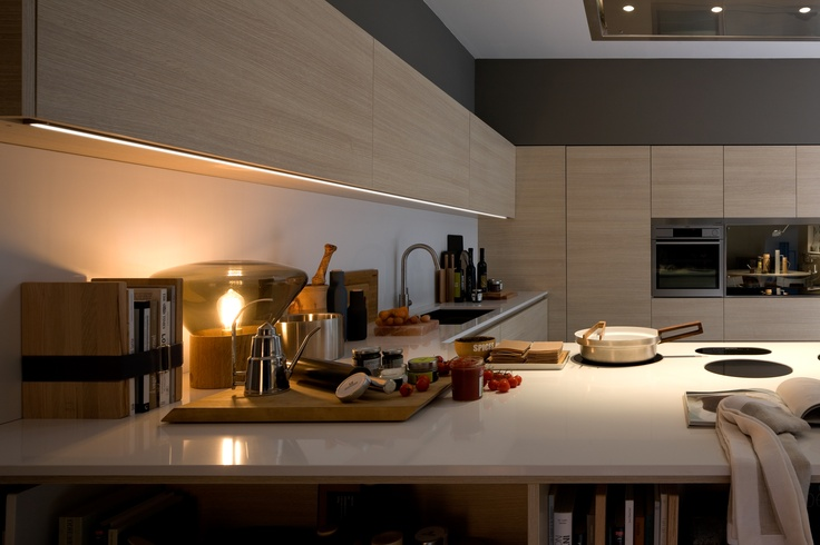 Between wall and base units, the LED lighting system run along the entire section above the worktop.  #kitchen #arclinea #design #interiordesign #home #architecture #architect #madeinitaly