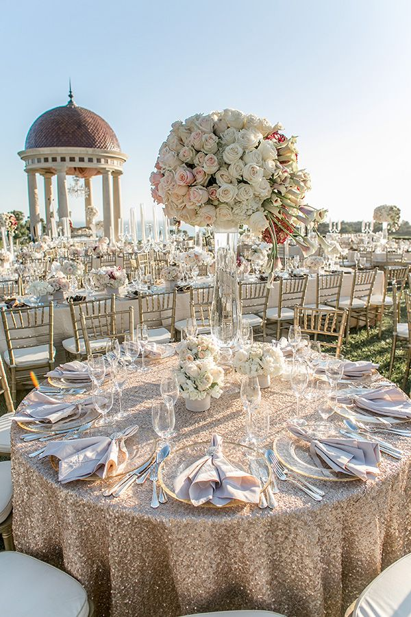 A dreamy Pelican Hill Resort wedding with Allure Events Atelier and Butterfly Floral & Event Design with purple and white jaw dropping decor.