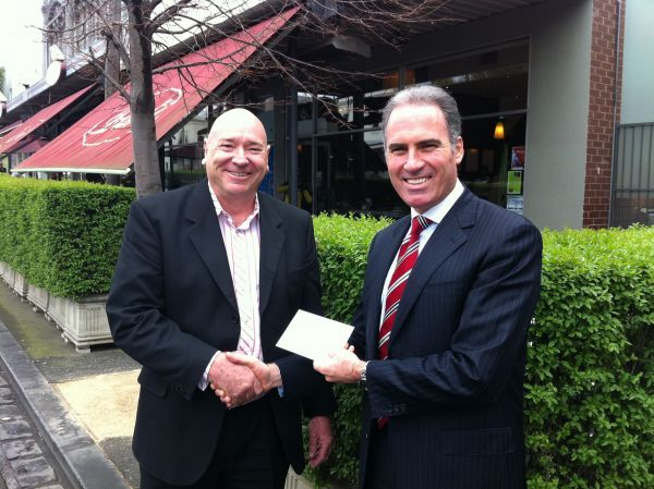 Our 2011 footy tipping winner, R. Andrews from Webb Australia, receives his cheque from Andrew Aston.