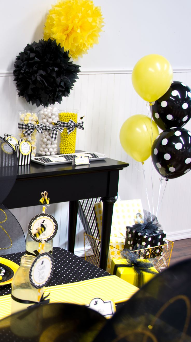Black and white polka dot balloons stand out against the yellow ones #BirthdayExpress #BumbleBee