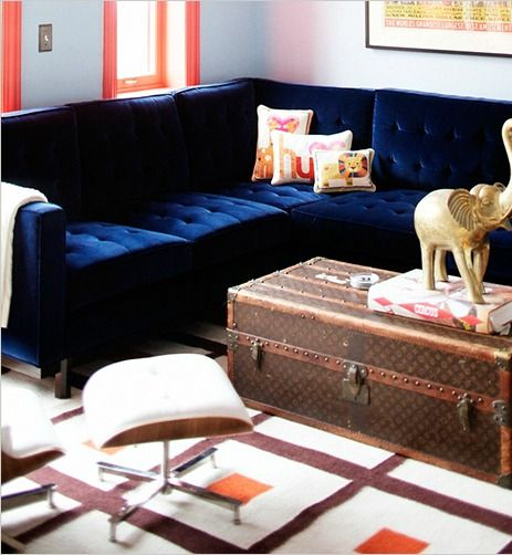 Orange accents work perfectly with this navy blue sofa - Navy blue velvet sofa ...