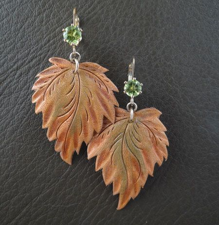 Carved Leather Leaf Earrings featuring Genuine Peridot set in 14 k Gold Filled Lever Backs. $240.00, via Etsy.