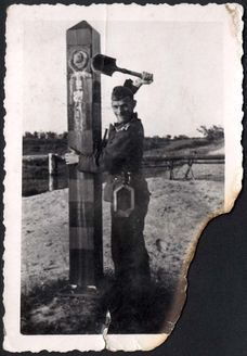 Ostroleka, Poland, 22 June 1941, A German soldier removing a Soviet symbol from a Soviet border sign near the town