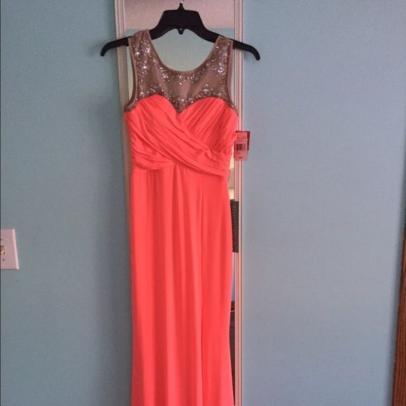 JcPenney prom dress - size 3 Never worn, never altered. Beautiful coral prom dress, with a slit down the side. Slim fitted. Dresses Prom